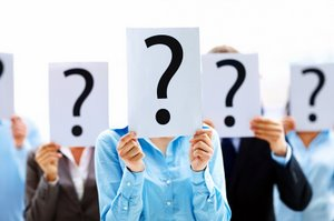 BUSINESS PEOPLE WITH QUESTION MARK- © Yuri Arcurs | Dreamstime.com