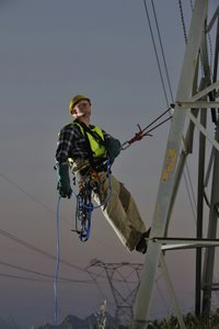 POWER UTILITY WORKER ABSEILING FROM PYLONS © Jaco Wolmarans | iStockPhoto