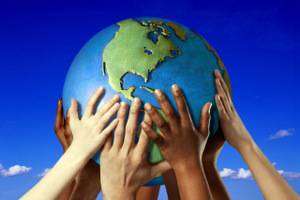 HANDS ON A GLOBE- Image by © Royalty-Free/Corbis