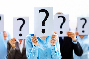 BUSINESS PEOPLE WITH QUESTION MARK © Yuri_arcurs | Dreamstime.com